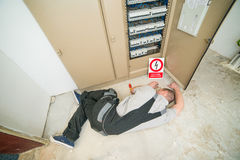 Electrician lying on the ground. Electrician electrocuted lying on the ground Stock Photo