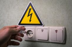 Electrician makes electrical measurements; jumps tension, elect Royalty Free Stock Image