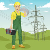 Electrician man standing near high voltage power lines in summer. Electrician man standing near high voltage power lines in the summer Royalty Free Stock Photography