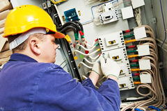 Electrician measure voltage and current Stock Photo