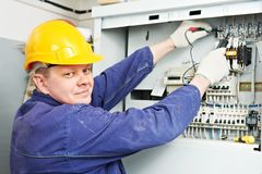 Electrician measure voltage with multimeter stock photography