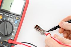 Electrician is measuring electronic valves. On desk stock images