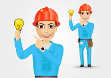 Electrician or mechanic pointing to a lamp Stock Photos