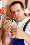 Electrician peeling wire endings Royalty Free Stock Image