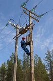 Electrician perform maintenance on the transmission towers reclo Royalty Free Stock Photos
