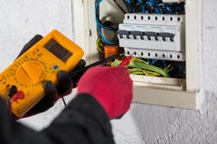 Electrician. Performing checks on a light box stock images