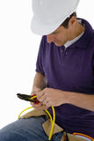Electrician with pliers stripping wire Stock Photo