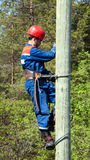 Electrician on a pole Royalty Free Stock Images