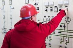 Engineer with red helmet give command in power plant control cen Royalty Free Stock Images