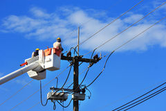 Electrician repair of  electric power system. On  hydraulic platform Stock Photo