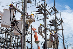 Electrician repair the transmission system. Electrician repair the high voltage transmission system Stock Photos