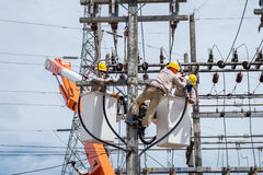 Electrician repair the transmission system. Electrician repair the high voltage transmission system Stock Photo