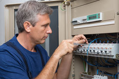 Electrician Repairing A Circuit Breaker stock images