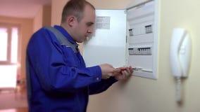 Closeup of electrician repairing circuit breaker. Electrician repairing circuit breaker. Static closeup shot stock video footage