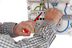 Electrician is repairing a connection royalty free stock images