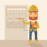 Electrician repairing an electrical panel Royalty Free Stock Images