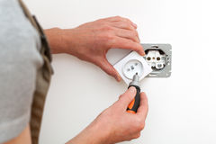 Electrician repairing socket royalty free stock photography
