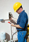 Electrician Repairing Sprinkler Pump stock photo