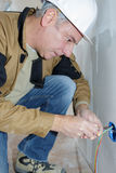 Electrician repairing tumbler switch in house royalty free stock photo