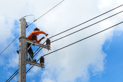Electrician repairing wire of the power line Stock Photo