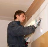 Electrician repairing wiring Royalty Free Stock Image