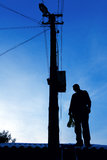 Electrician on the roof. Looking around before repairs power line Stock Photo