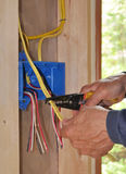 Electrician S Hand Stripping Wire