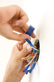 Electrician s hands Stock Images