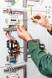 Electrician`s hands working Royalty Free Stock Photography