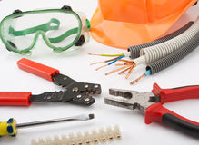 Electrician's tools. Hardhat, pliers, cables, cutter, screwdriver and other Royalty Free Stock Photos