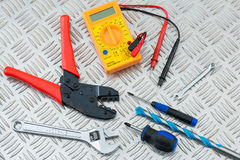 Electrician`s Tools and Equipment on Metal Checker Plate Stock Photos