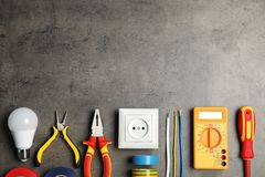 Electrician`s tools and space for text on gray background stock images