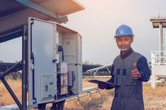 Electrician showing thumbs up for great performance energy at so. Lar power plant stock photo