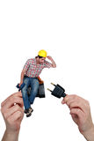 Electrician sitting on a plug Stock Photos