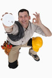 Electrician with a smoke alarm Stock Photography