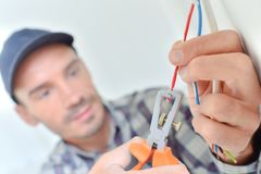 Electrician snipping a wire. Building royalty free stock image