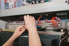Electrician specialist checking low-voltage cabinet equipment Stock Photography