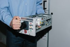 Electrician specialist checking low-voltage cabinet equipment Stock Photo