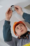 Electrician at spot light installation Royalty Free Stock Images