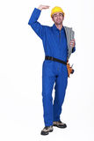 Electrician stood with coil Stock Photography