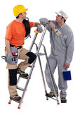 Electrician stood with painter Stock Photos
