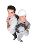 Electrician stood with young probationer Stock Images