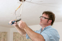 Electrician Straightens Wire Royalty Free Stock Image