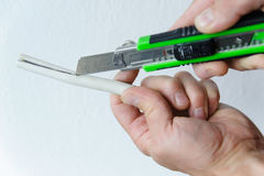 Electrician stripping white wire Stock Images