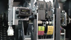 The electrician switch on the circuit breakers and starts the system high voltage. Part of high-voltage substation with