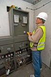 Electrician in switching power Royalty Free Stock Photography