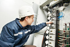 Electrician switching on  power line box Royalty Free Stock Photo
