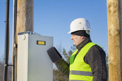 Electrician with tablet PC Stock Photo