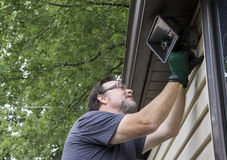 Electrician Taking Down Exterior Light Stock Photography