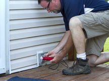 Electrician Testing A Outside Outlet Royalty Free Stock Photography